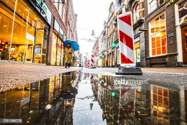 Empty shopping street after the forced Coronavirus lockdown on December 15, 2020 in Zwolle, Netherlands. The Netherlands government has forced...