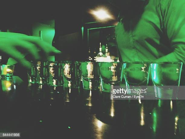 Empty Shot Glasses In Bar Counter