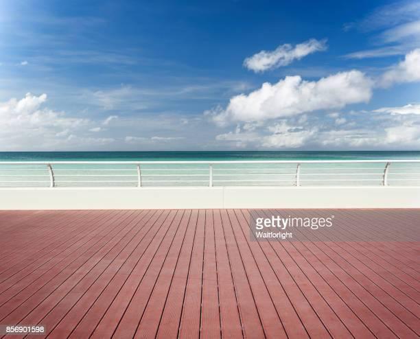 empty sidewalk with beach background