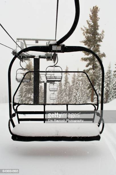 empty ski lift on snowy mountainside - ski lift stock pictures, royalty-free photos & images