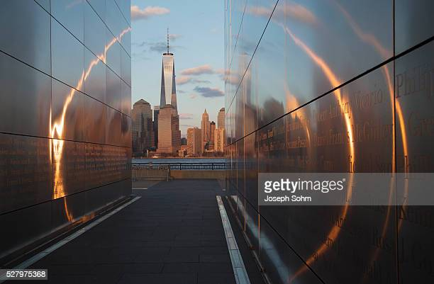 Empty Sky: Jersey City 9/11 Memorial at sunset shows One World Trade Center (1WTC), Freedom Tower th