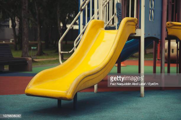 empty slide in playground - slide play equipment stock pictures, royalty-free photos & images