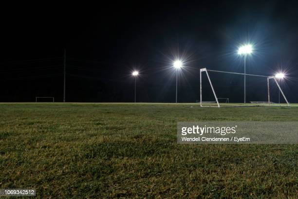 empty soccer field against sky at night - sports field stock pictures, royalty-free photos & images