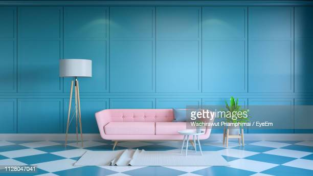 empty sofa against wall at home - indoors stock pictures, royalty-free photos & images