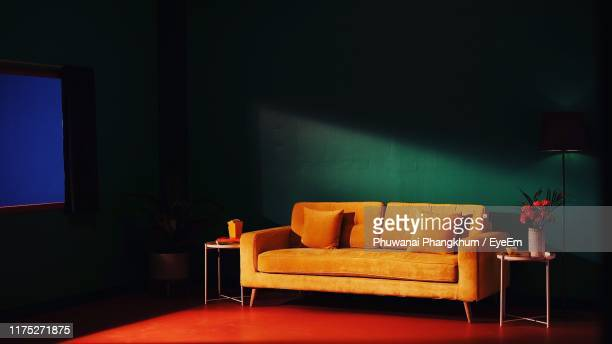 empty sofa against wall at home - cushion stock pictures, royalty-free photos & images