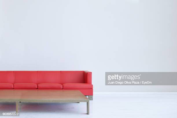 Empty Sofa Against White Wall At Home