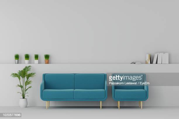 empty sofa and chair and wall - empty room stock pictures, royalty-free photos & images