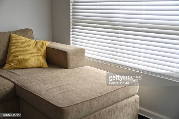 empty sofa in home livingroom - rafael ben ari - fotografias e filmes do acervo