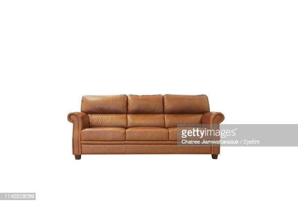 empty sofa on white background - sofa stock-fotos und bilder