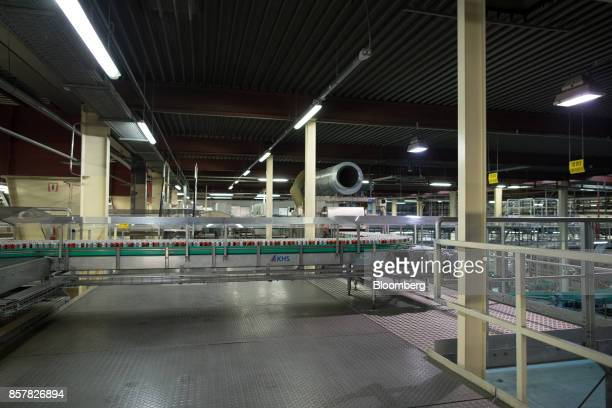 Empty softdrink cans pass along a conveyor inside the Refresco Group NV beverage bottling factory in Maarheeze Netherlands on Thursday Oct 5 2017...