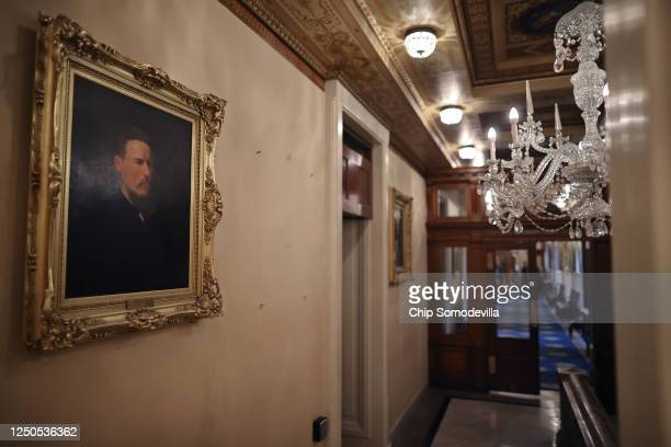 Empty spaces remain on the wall where portraits of former Speakers of the House of Representatives who were also Confederates were taken down at the...