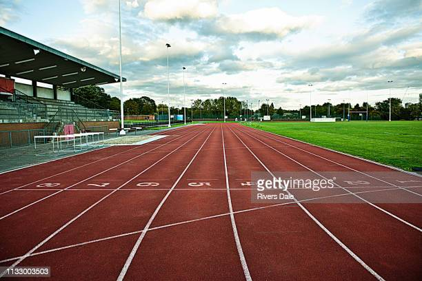 empty sportstrack and stadium - running track stock pictures, royalty-free photos & images
