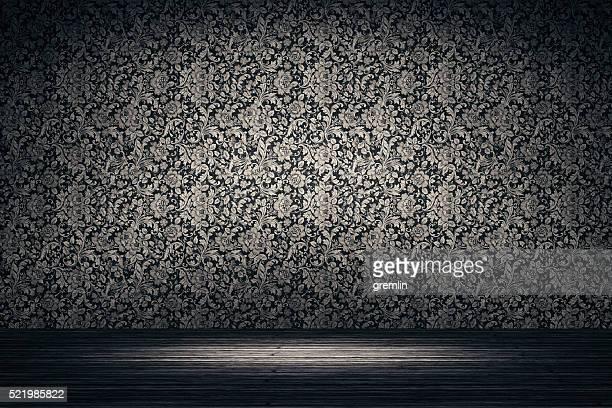 Leere Spotlit Zimmer mit Blumen Muster Hintergrund