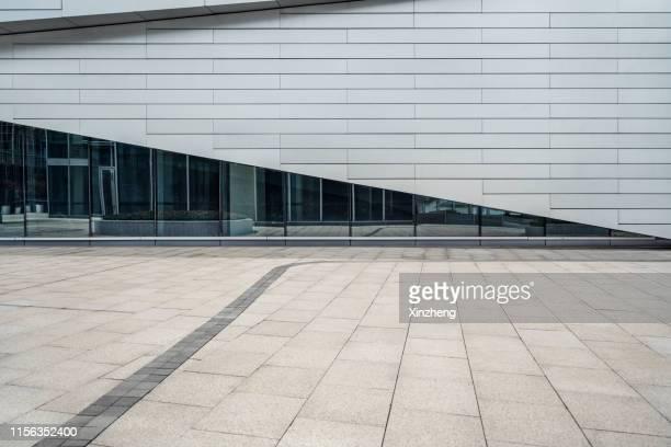 empty square by modern architectures - 人気のない道路 ストックフォトと画像