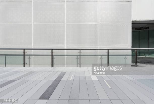 empty square by modern architectures - pedestrian walkway stock pictures, royalty-free photos & images
