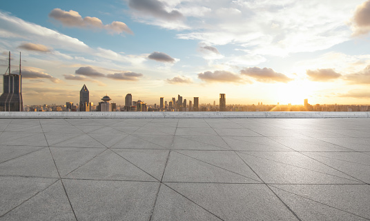 Empty square floor and with cityscape and skyline at sunset in Shangha - gettyimageskorea