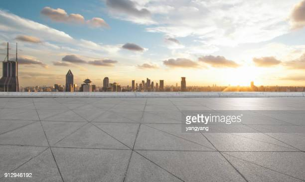 empty square floor and with cityscape and skyline at sunset in shangha - empty city stock pictures, royalty-free photos & images