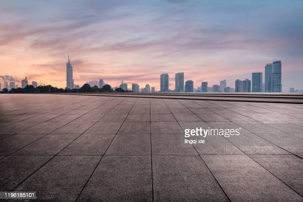 empty square of nanjing of china.road background of automobile advertising.. - construction platform stock pictures, royalty-free photos & images