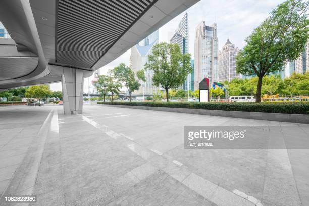 empty square under elevated walkway,shanghai,china - 歩道橋 ストックフォトと画像