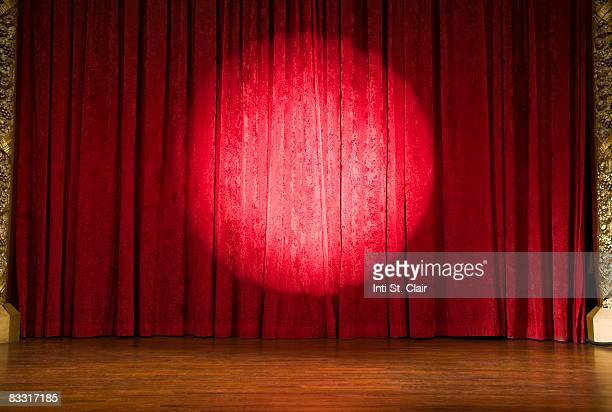 empty stage with curtains closed and spotlight on - stage curtain stock pictures, royalty-free photos & images