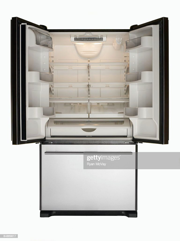 Empty stainless steel refrigerator, doors open : Stock Photo
