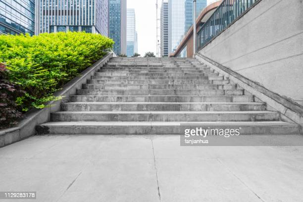 empty staircase between modern office buildings - steps stock pictures, royalty-free photos & images
