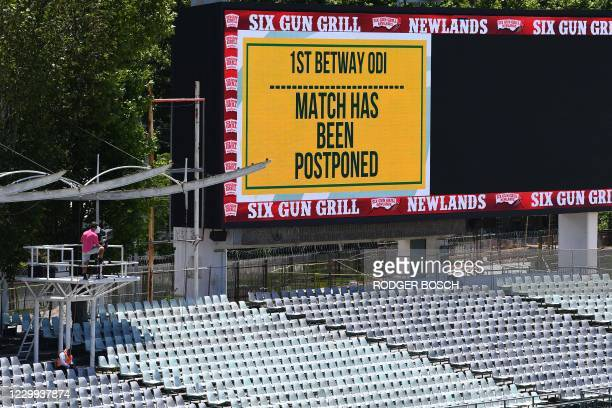 Empty stands and a message of the match postponement on the screen are seen at Newlands stadium in Cape Town, South Africa, on December 4, 2020. -...