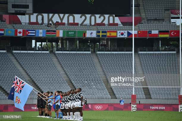 Empty stands are seen as teams sing the national anthem before the men's final rugby sevens match between New Zealand and Fiji during the Tokyo 2020...