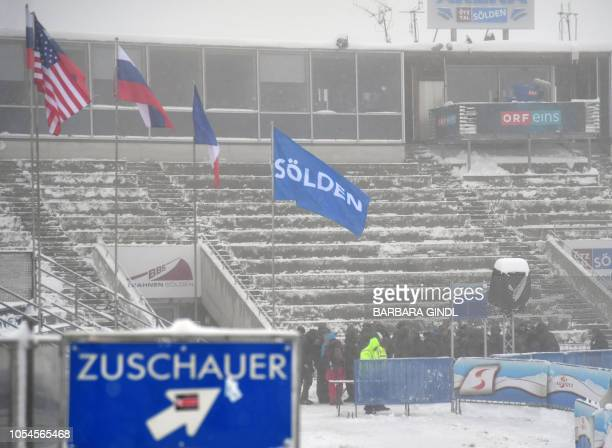 Empty stands near the finish line are pictured on October 28 2018 in Solden as the FIS Alpine Ski World Cup season opener on the Rettenbach glacier...