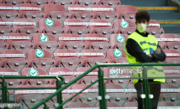 Empty stands with signs where it is allowed for fans to sit before the start of the Serie A match between FC Internazionale and ACF Fiorentina at...