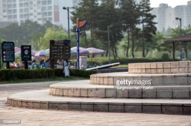 empty steps against trees at sangdong lake park - bucheon stock pictures, royalty-free photos & images