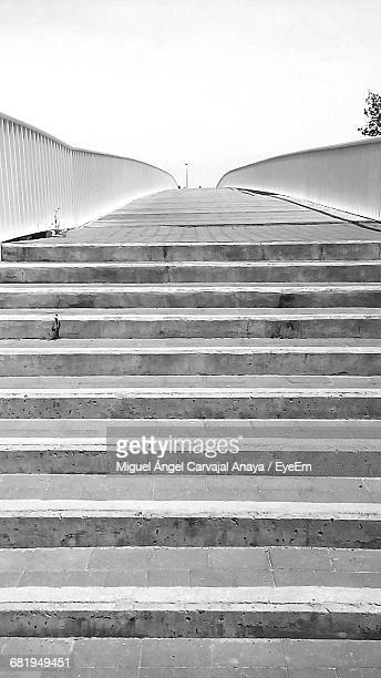 empty steps leading towards walkway against clear sky - carvajal stock photos and pictures