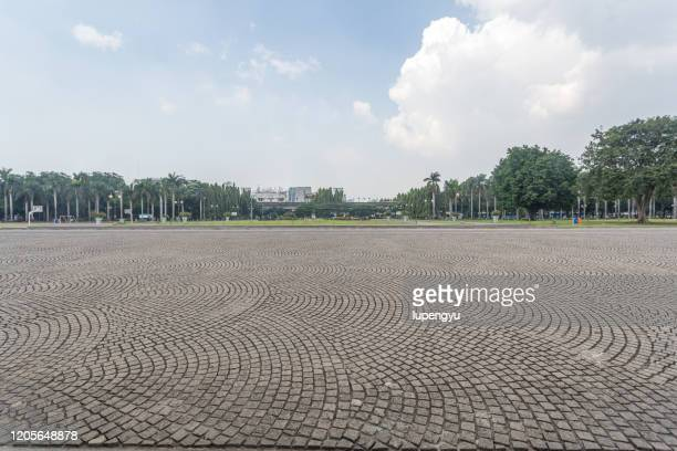 empty stone roadway - paving stone stock pictures, royalty-free photos & images