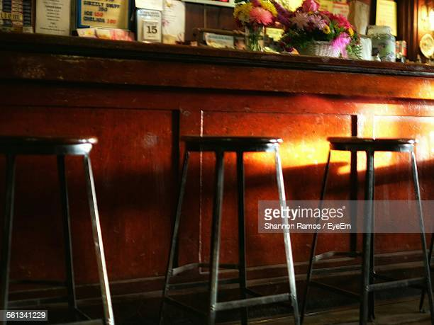 empty stool in bar - stool stock pictures, royalty-free photos & images