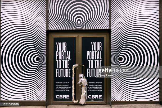 Empty store in the Bond Street, normally one the capital's most exclusive West End streets, during the third lockdown of the Coronavirus pandemic, on...