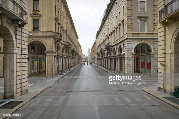 empty street amidst buildings in city - government shutdown stock pictures, royalty-free photos & images