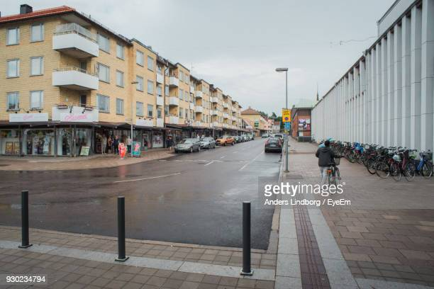 empty street and buildings in city - extreme weather stock photos and pictures
