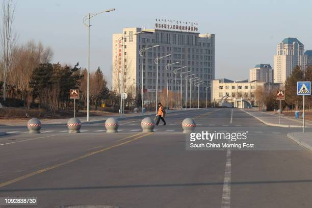 Empty street in Kangbashi district Ordos city Inner Mongolia on Feb 17 2017 Kangbashi is a totally new district built on desert the local...