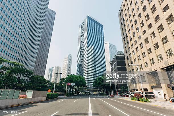 empty street in shinjuku ward, tokyo, japan - thoroughfare stock photos and pictures