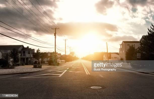 empty street in suburban residential area at sunset, new jersey, usa - suburban stock pictures, royalty-free photos & images