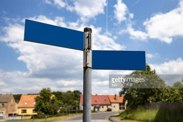 empty street name signs in a tiny village - identity stock pictures, royalty-free photos & images