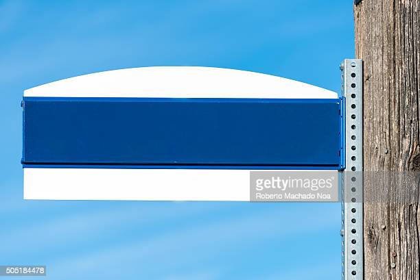 Empty street sign attached to an electric pole in urban area Copy space for placing text inside the image