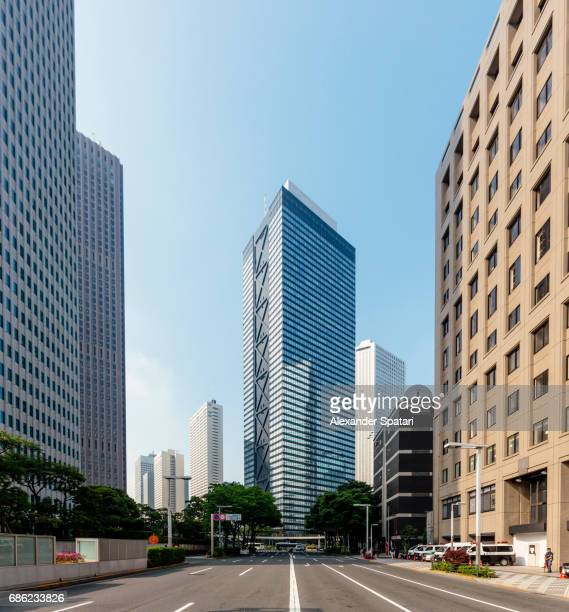Empty street with modern office buildings in Shinjuku district, Tokyo, Japan