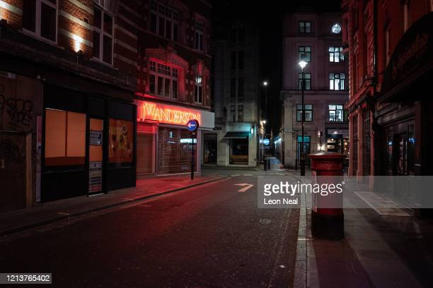 Empty streets and alleyways are seen around Soho at what would usually be a busy period of Friday night revelry on March 20 2020 in London England...