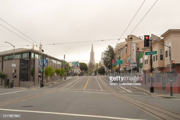 Empty streets are visible leading to the Transamerica Pyramid building during a shelter in place order in San Francisco California during an outbreak...