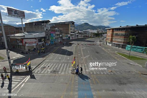 Empty streets as peaceful blockades continue in various sectors such as La Luna during national strike against Ivan Duque's administration on May 12,...