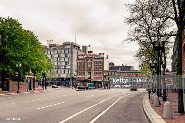 empty streets in harvard square, cambridge during the covid-19 pandemic - cambridge massachusetts stock pictures, royalty-free photos & images
