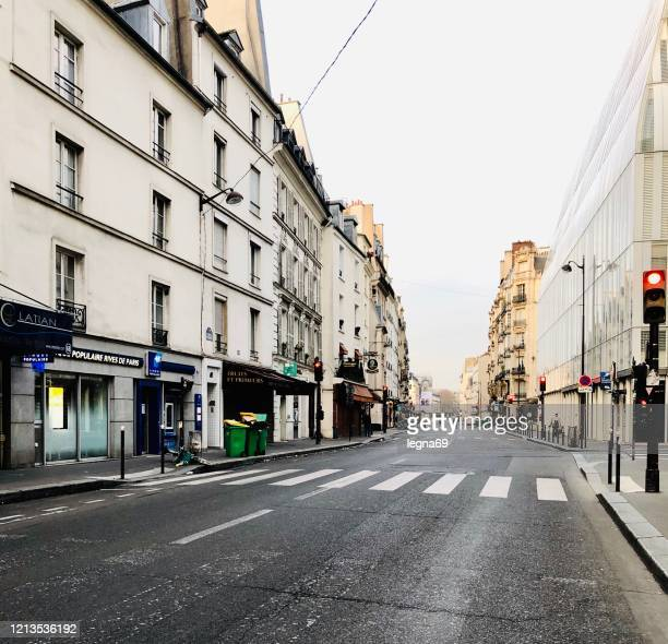 empty streets in paris, during pandemic 2020 in europe. - curfew stock pictures, royalty-free photos & images