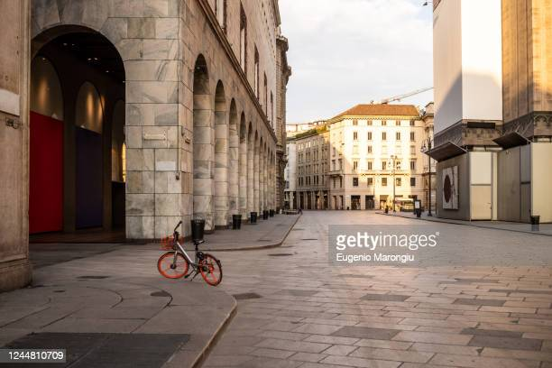 empty streets in the city of milan during the corona virus lockdown period - italy stock pictures, royalty-free photos & images