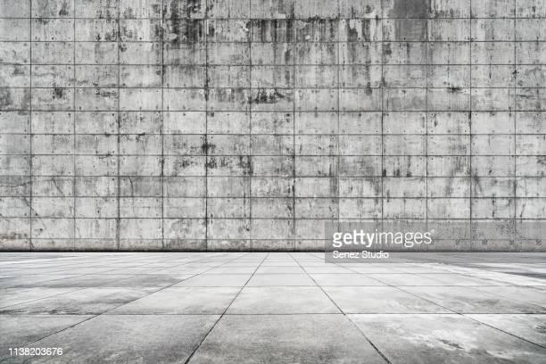 empty studio background, concrete texture - stone wall stock-fotos und bilder